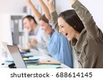 three excited employees... | Shutterstock . vector #688614145