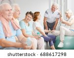 happy elders sitting on... | Shutterstock . vector #688617298