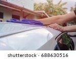 hand hold sponge over the white ... | Shutterstock . vector #688630516
