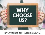 Small photo of Female hands holding wooden blackboard / Female hands holding wooden blackboard with text why choose us ?