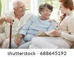 two elder people are looking at ... | Shutterstock . vector #688645192