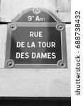 Small photo of Paris, France - Rue de la Tour des Dames old street sign. Black and white vintage style.