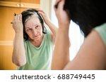 senior woman checking her gray... | Shutterstock . vector #688749445