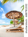 beach chairs on exotic tropical ... | Shutterstock . vector #688781332