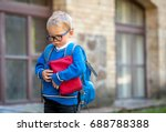 sad and unhappy child with book ... | Shutterstock . vector #688788388