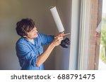 man in a blue shirt does window ... | Shutterstock . vector #688791475