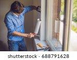 man in a blue shirt does window ... | Shutterstock . vector #688791628