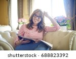 cropped shot of a happy middle... | Shutterstock . vector #688823392