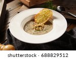creme soup with mushrooms in... | Shutterstock . vector #688829512