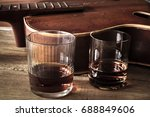 two glasses of whiskey and old... | Shutterstock . vector #688849606