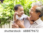 grandfather and grandson are... | Shutterstock . vector #688879672