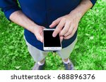 man  using a smart phone  in... | Shutterstock . vector #688896376