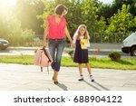 mom and schoolgirl of primary... | Shutterstock . vector #688904122