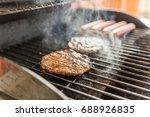 hamburgers and hotdogs grilling ... | Shutterstock . vector #688926835