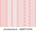 wide lace ribbons set on a pink ... | Shutterstock .eps vector #688975396