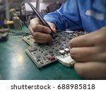 soldering electronic parts on... | Shutterstock . vector #688985818