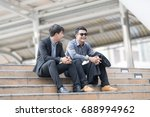 two of asian business people at