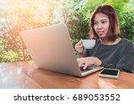 asian business woman using a... | Shutterstock . vector #689053552