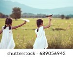 back view of two asian child... | Shutterstock . vector #689056942