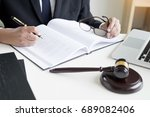 lawyer hand writes the document ... | Shutterstock . vector #689082406