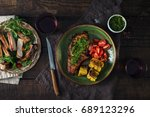 grilled steak with chimichurri... | Shutterstock . vector #689123296