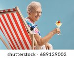 elderly woman with a cocktail... | Shutterstock . vector #689129002