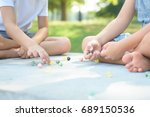 kids playing marbles game... | Shutterstock . vector #689150536