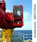 Small photo of Crane operation, Crane boom, Crane cabin room at offshore wellhead platform.