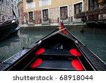 Gondola sailing in Venice channel, Italy - stock photo