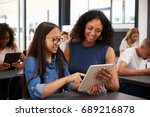 teacher helping teenage... | Shutterstock . vector #689216878