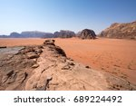 stone road in the wadi rum... | Shutterstock . vector #689224492