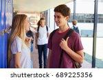 two friends talking in school... | Shutterstock . vector #689225356