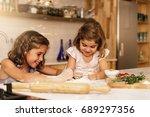 little sisters girl preparing... | Shutterstock . vector #689297356