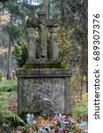 Small photo of Old tombstone in a cemetery at All Saints Day, Munich, Bavaria, Germany, Europe, 2. November 2010