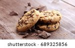 Small photo of Chocolate cookies on wooden table. Chocolate chip cookies shot