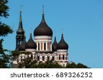 Small photo of Domes of Alexander Nevsky Orthodox Cathedral and spire of St. Mary's Church in the Old Town of Tallinn, Estonia.