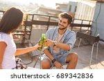 young couple enjoying hot...   Shutterstock . vector #689342836