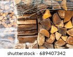 log pile with wrapped logs in... | Shutterstock . vector #689407342