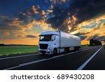 truck transportation at sunset | Shutterstock . vector #689430208