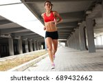female runner jogging on the... | Shutterstock . vector #689432662