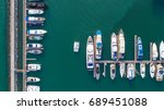 pier speedboat. a marina lot.... | Shutterstock . vector #689451088