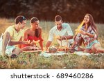 group of friends  sitting on... | Shutterstock . vector #689460286
