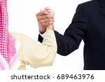 shake hand between arab and man ... | Shutterstock . vector #689463976