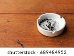 closeup white ashtray on wooden ... | Shutterstock . vector #689484952