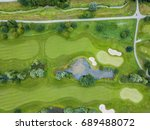 aerial view of footpath on golf ... | Shutterstock . vector #689488072