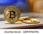 golden bitcoins on the laptop