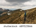 men hikers walking on mountain... | Shutterstock . vector #689525866