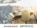 cup of hot coffee  reading... | Shutterstock . vector #689534152