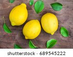 green leaf with lemon on wooden ... | Shutterstock . vector #689545222