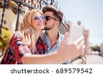 couple in love standing on the... | Shutterstock . vector #689579542